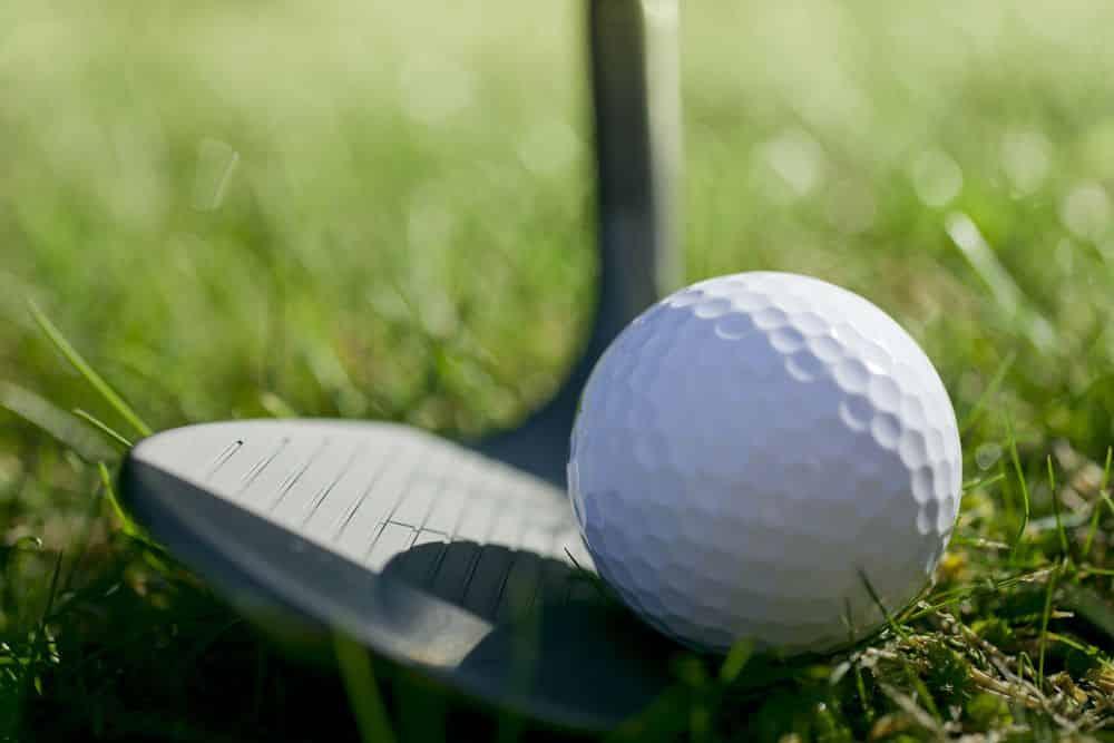 Golf Wedge Under Ball On Grass